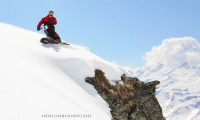 SNOWSCOOT RIDER BINIOU CARVING OVER ROCKS IN LA CHAUX VERBIER