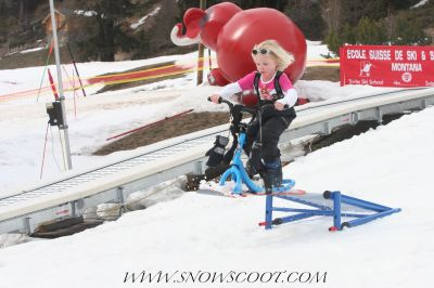 SNOWSCOOT RIDER CAMILLE PETOUD JUMPING IN THE KIDS SNOWPARK OF CRANS MONTANA