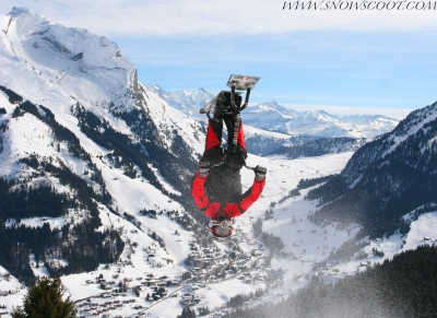 SNOWSCOOT RIDER ERIC FORNEY FLIPPING INTO THE VALLEY OF LA CLUSAZ