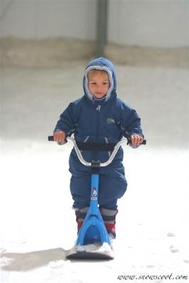 Tom Pouce riding his kidscoot