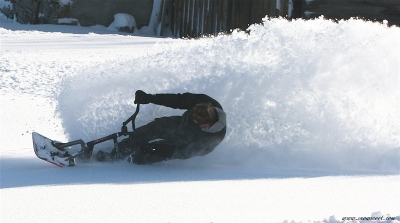 SNOWSCOOT RIDER MAKING A WAVE