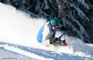 SNOWSCOOT RIDER IN FAT POWDER